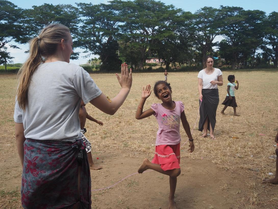 Projects Abroad High School Special volunteers play games with children at their Care and Community placement in Fiji.
